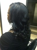 Natural Hair flat-ironed and curled