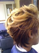 Natural textured hair colored and straightened.