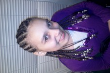 Three layer cornrows with beads at the ends