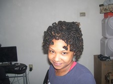 Locs curled and styled into an updo
