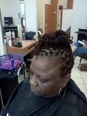 Locs that were colored, interlocked, and styled
