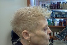 short and sassy textured cut with blond hair coloring.