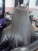 After - Relaxed,Flat-Ironed,and cut