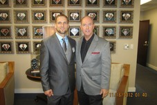 Will with Advocare President, CEO Richard Wright in front of the Diamond wall at the Advocare headquarters in Texas.