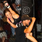 Will lifting Britani up after her last victory. Advocare provides them the opportunity to celebrate success and victory both in and out of the cage.