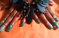 Acrylic nails with designer art.