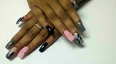 Full set in medium length with beads and nail art