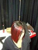 Model backstage at one of our Hair shows. Graffiti style placement with our HD Reds!