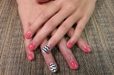This client has been a nail-biter for a long time, so we did tips cuts short with acrylic enhancements and Shellac polish. Good as new!