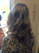 Back view of gorgeous light brown/dark blonde highlights with body and wave! Spring here we come...