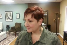 Michelle is so fun...the red really brings out this short razor cut
