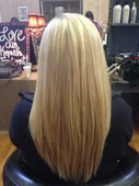 Smooth and straight long layers with perfect light blonde highlights.