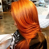 Natural hair corrective color. Her hair was red and black. I made it a rich copper brown with an assortment of warm caramel and golden highlights.